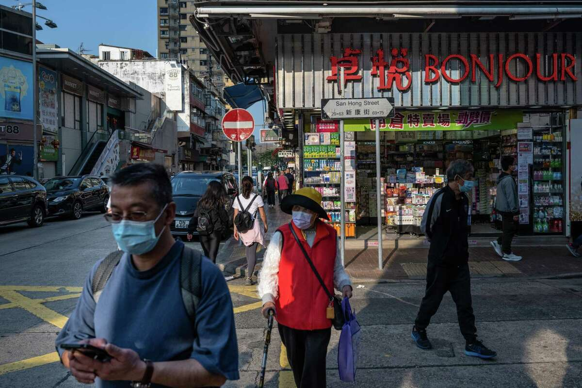 Pedestrians Hong Kong. A raft of economic data from China added to signs of recovery from the coronavirus pandemic.