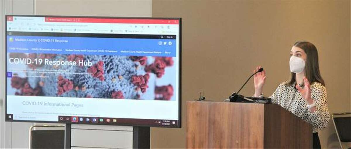 Becca Chausse of the Madison County Health Department talks about information and online resources during a press briefing at the Madison County Health Department's vaccination center at Gateway Convention Center in Collinsville on March 10.