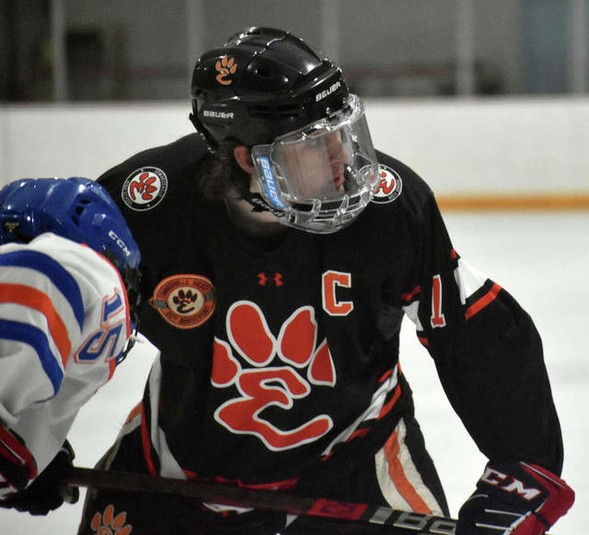 Edwardsville captain Cameron Gillen prepares to take a face-off during a game against Freeburg-Waterloo inside the East Alton Ice Arena.