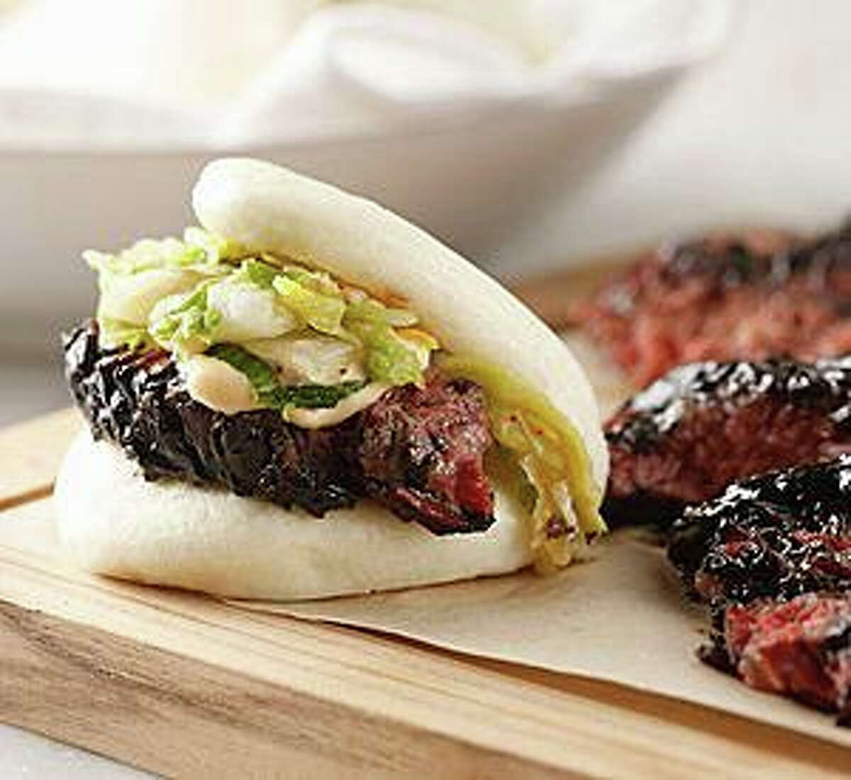 The fare at The Cottage restaurant features accents from a variety of ethnic cuisines, like the Wagyu brisket steamed buns.