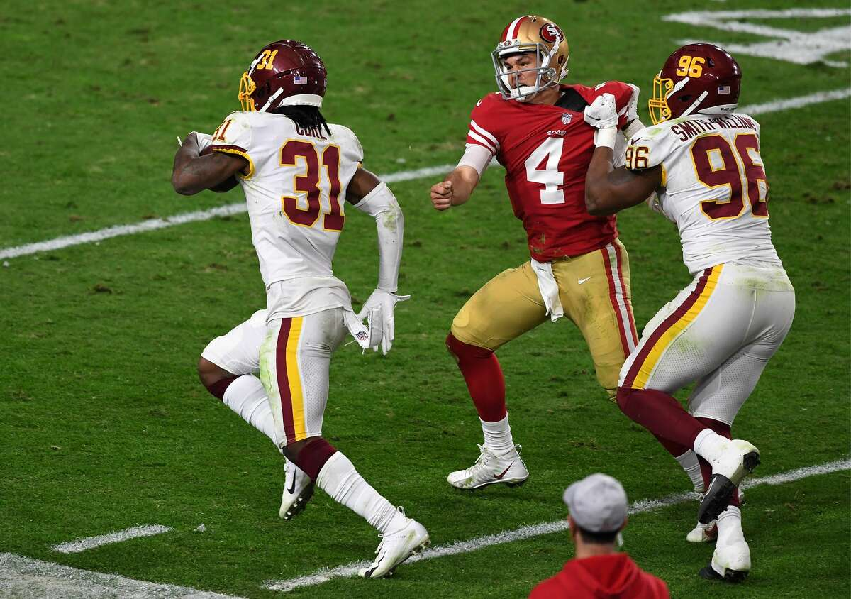 Strong safety Kamren Curl of the Washington Football Team runs for a touchdown on an interception thrown by quarterback Nick Mullens of the San Francisco 49ers on Dec. 13, 2020.