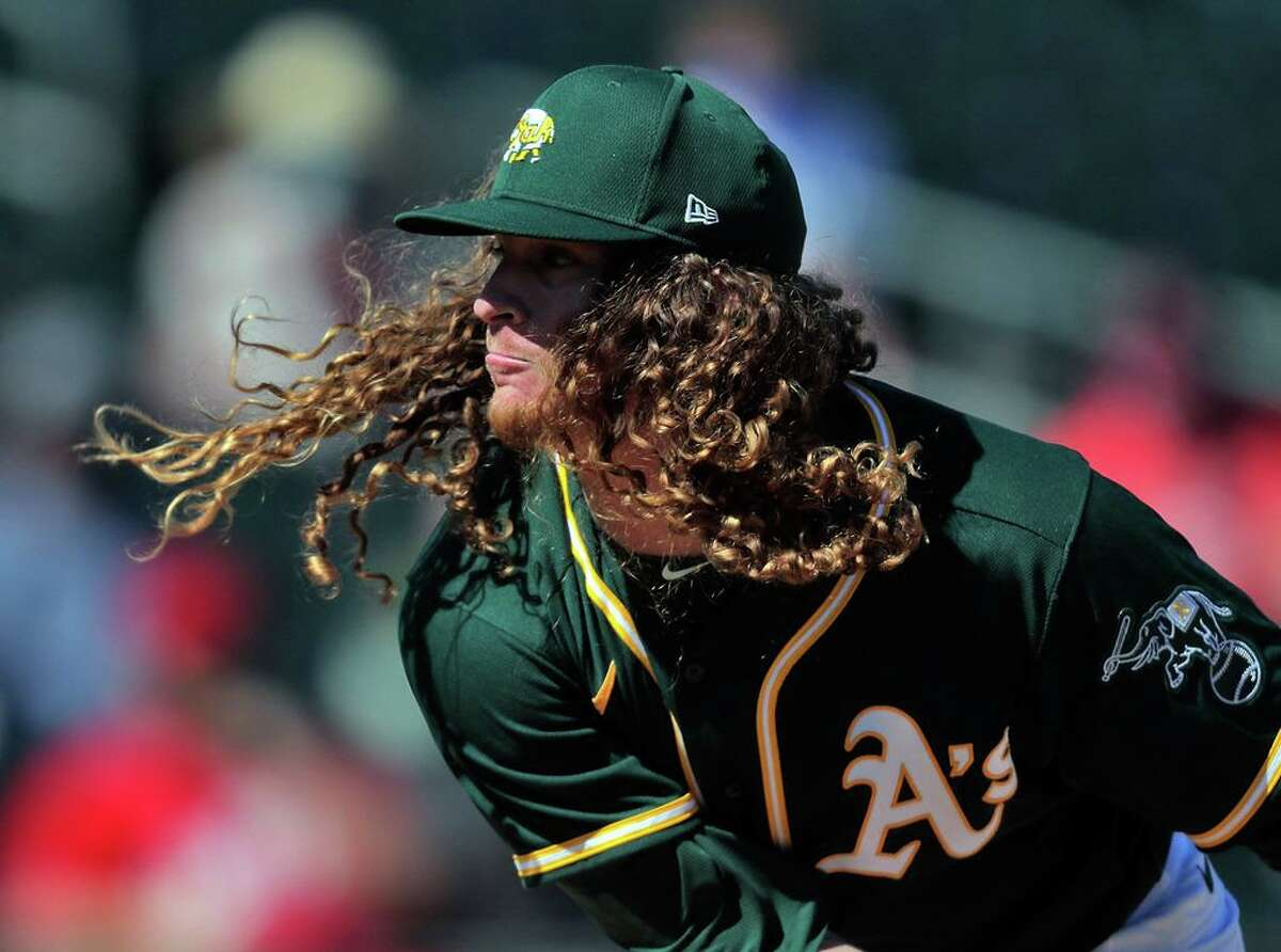 Grant Holmes (67) started for the Oakland Athletics as they took on the Cincinnati Reds at Hohokam Stadium in Mesa, Ariz., on Monday, March 1, 2021.