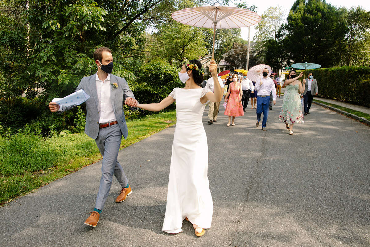 New state guidance on weddings means larger guest lists, but many safety guidelines, too. Masks, for instance, will still be a part of 2021 nuptials, at least for now. (isabelleselbyphotography.com)