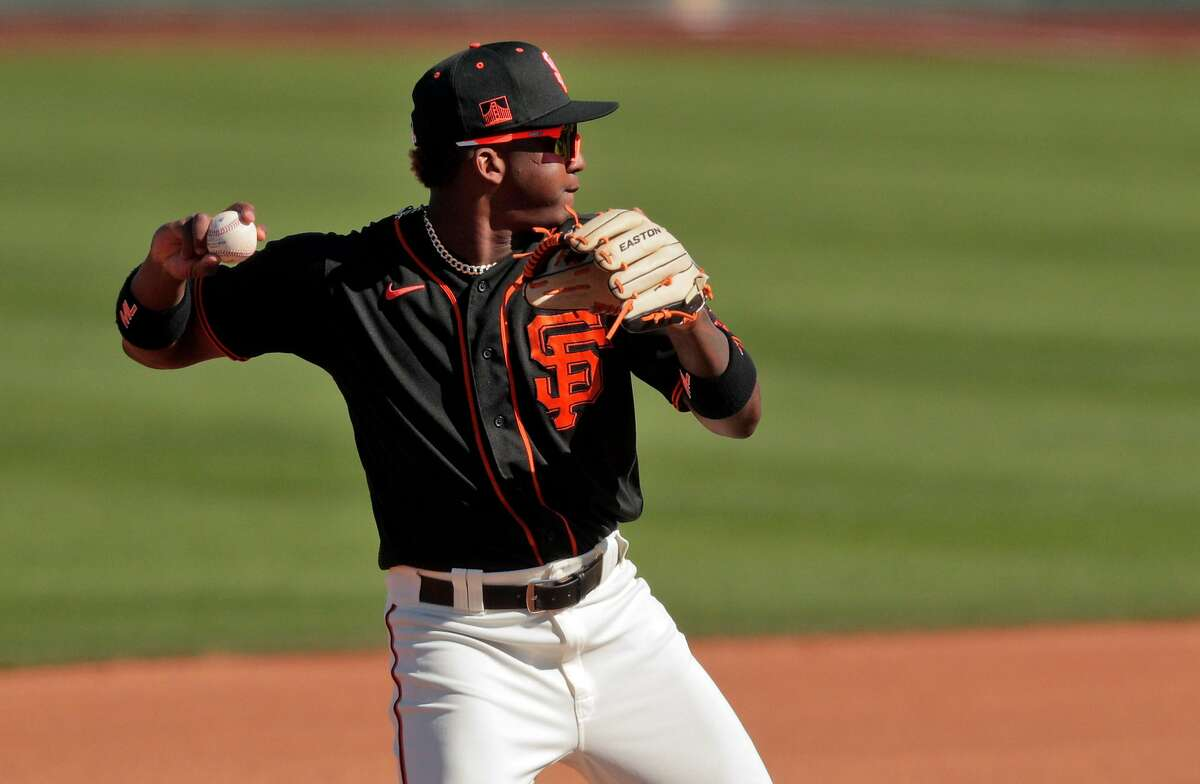 Marco Luciano, who began spring training 1-for-16 with 11 strikeouts, was sent by the Giants to the minor leagues on Monday.