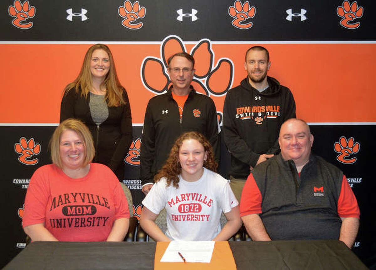 Edwardsville senior Jordan Mercer, seated center, has signed a letter of intent to swim at Maryville University. She is joined by her parents, EHS assistant coach Brooke Osborn, District 7 aquatics director Bob Rettle and EHS head coach Christian Rhoten.