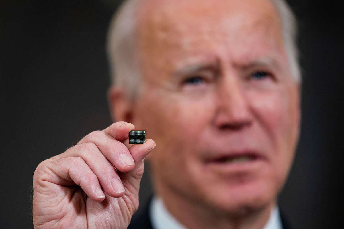 WASHINGTON, DC - FEBRUARY 24: U.S. President Joe Biden holds a semiconductor during his remarks before signing an Executive Order on the economy in the State Dining Room of the White House on February 24, 2021 in Washington, DC.