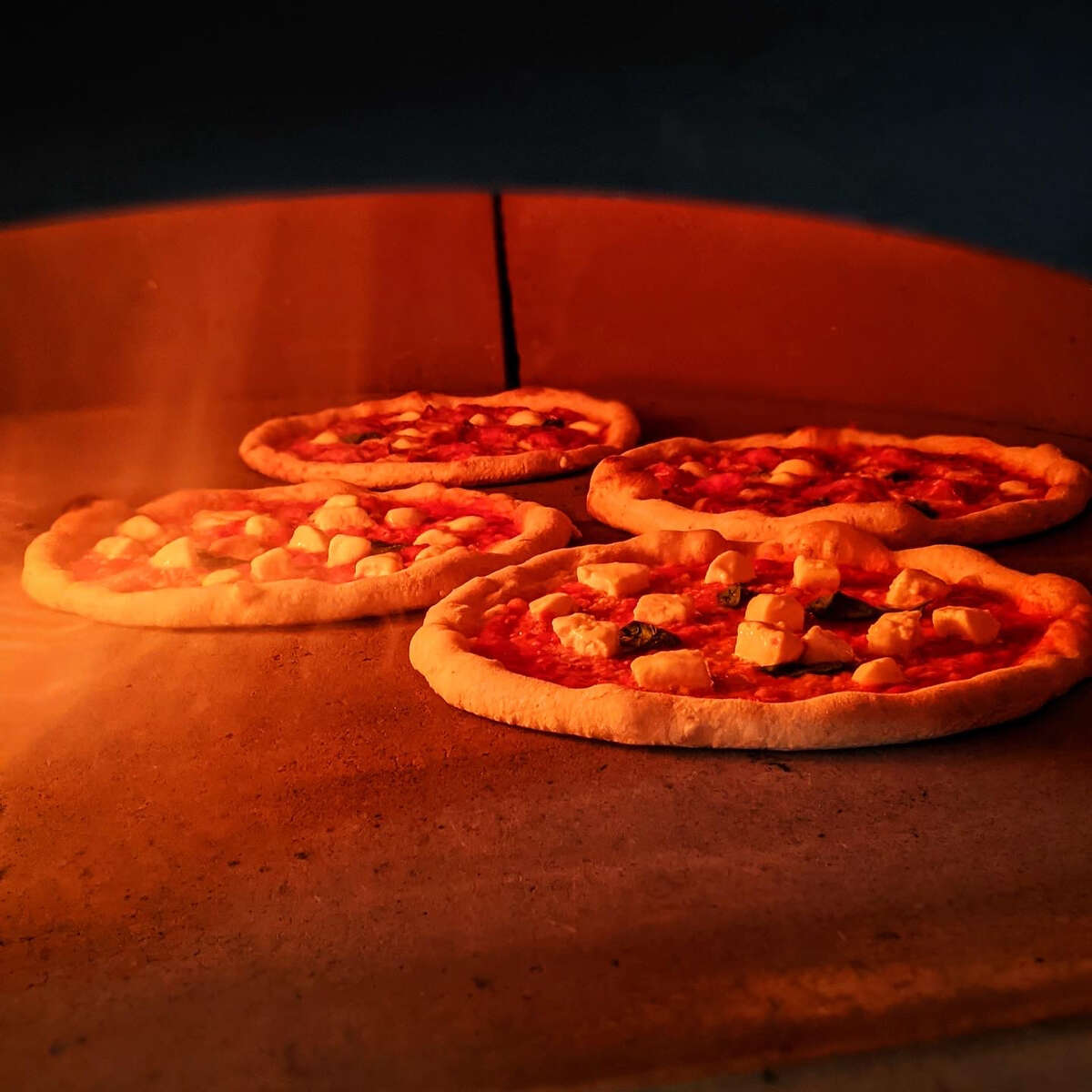 Inside the wood-fired pizza oven at Nic's Trattoria in East Greenbush. (Photo by Drew Harris/Nic's Trattoria.)