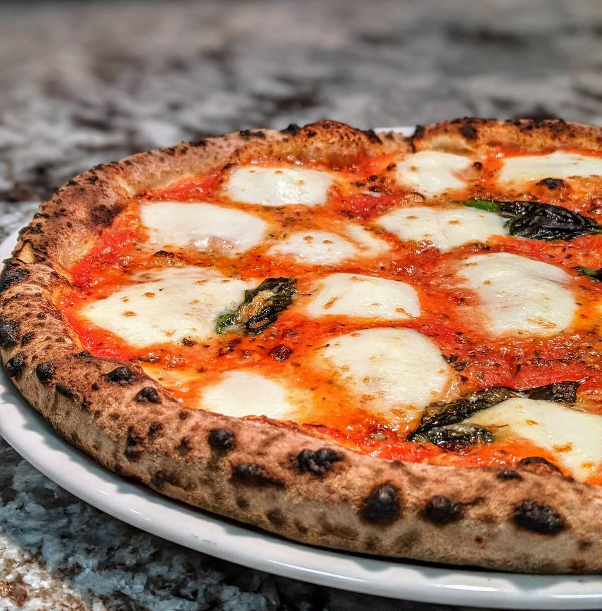 Pizza is cooked in a 750-degree wood-fired oven at Nic's Trattoria in East Greenbush. (Photo by Konrad Odhiambo/For the Times Union.)