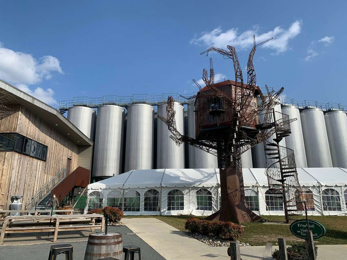 The Milton location of the DogFish Head Brewery. The steampunk tree sculpture was once at a Burning Man festival.
