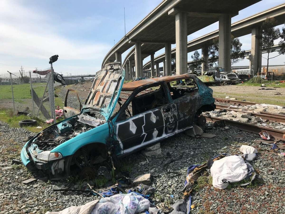 An abandoned car in Oakland, Calif., March 2021.