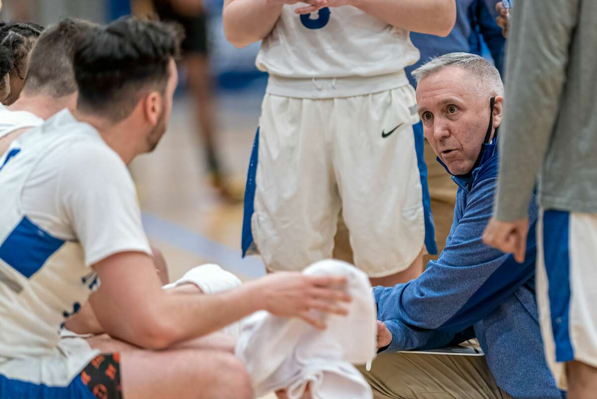 Daemen head coach Mike MacDonald talks to his team in an NCAA Division II regional tournament game against Bloomfield on Sunday, March 15, 2021, at Albany Capital Center. McDonald said the season had a lot of ups and downs dealing with the coronavirus pandemic. (Robert Simmons/ACC)