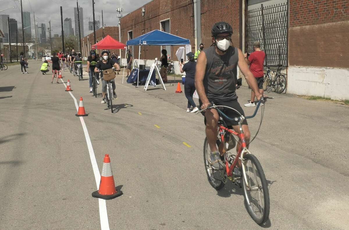 Cyclists trek through a pop-up bike lane in Houston's East End on Saturday, March 13, 2021. This stretch of impromptu bike trail could become a reality under the East End Bike Plan.