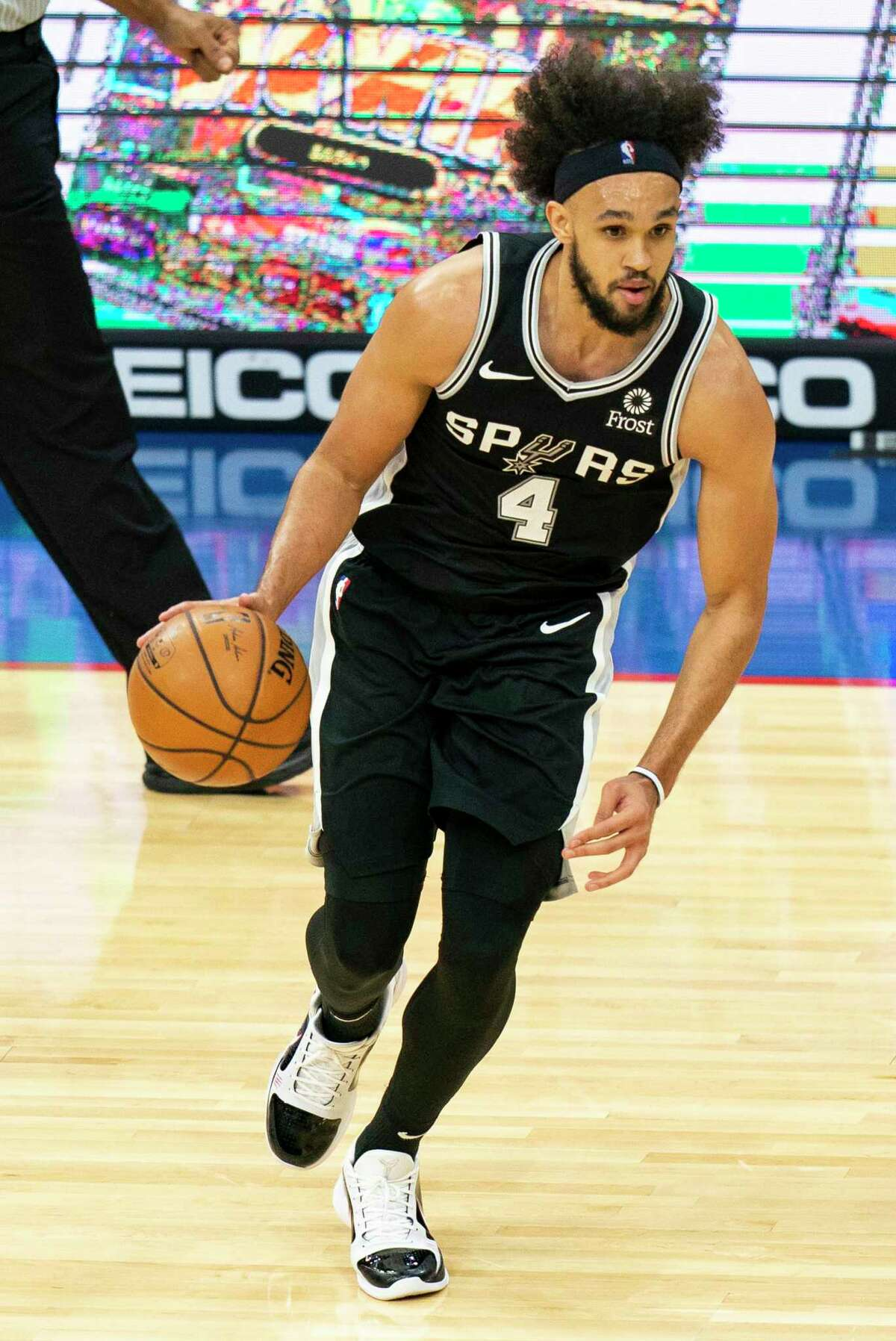 The Spurs' Derrick White dribbles up court during the second half against the 76ers on Sunday, March 14, 2021, in Philadelphia.
