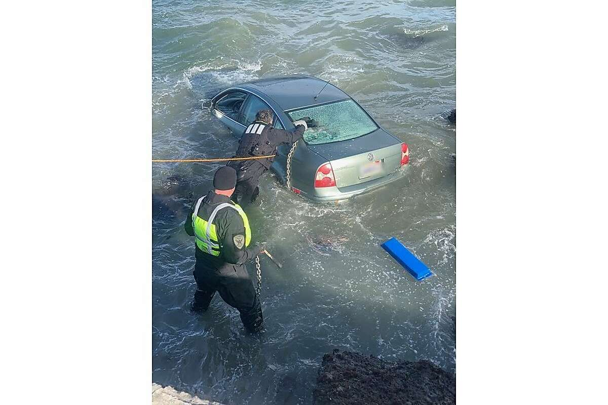 San Francisco firefighters rescued a person who is believed to have accidentally driven into the bay off the Marina Green park Sunday night.