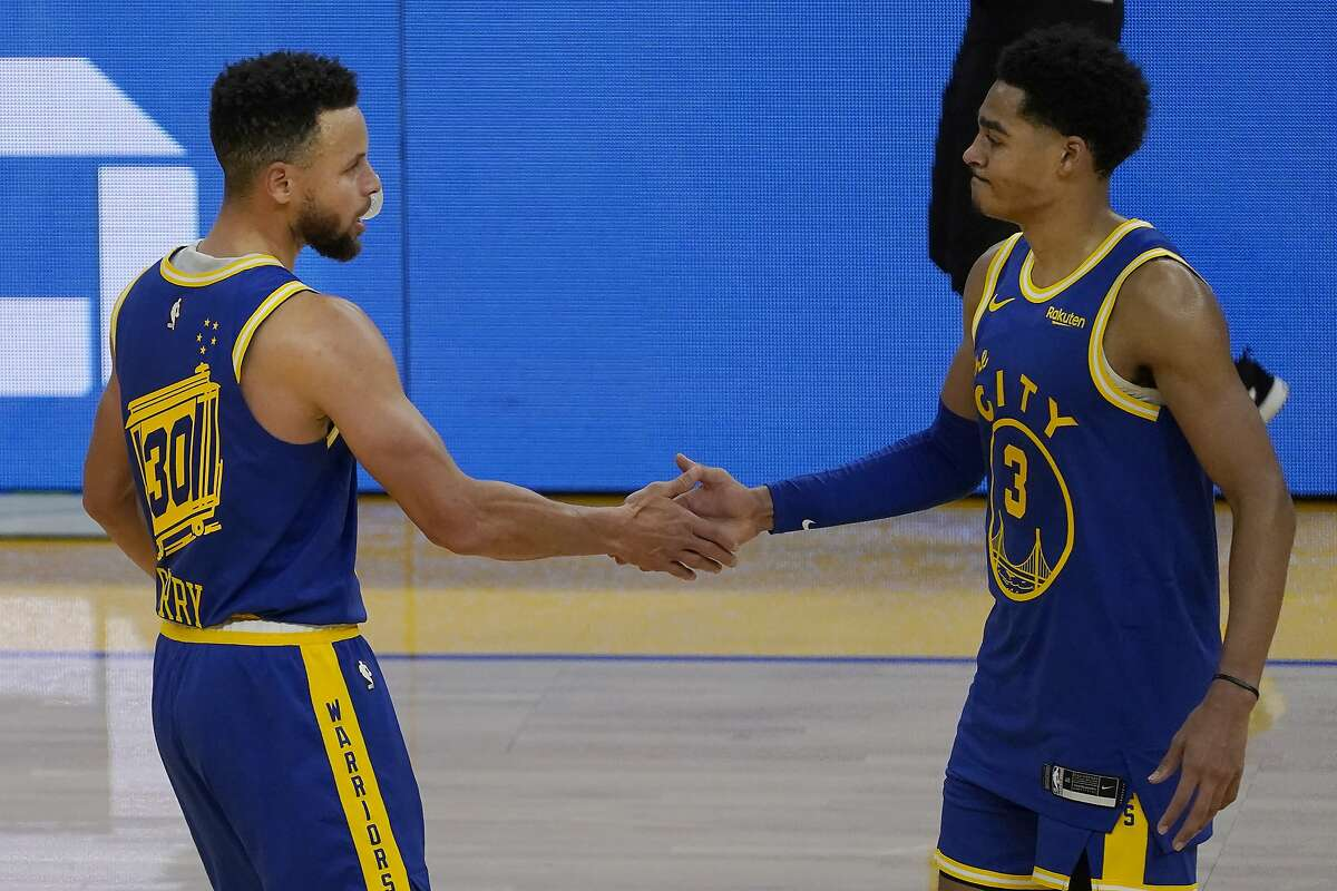 Stephen Curry, left, offers a postgame handshake to Jordan Poole after the Warriors' defeat of Utah on Sunday. Poole scored the second-most points (18) and played the second-most minutes (22) of any of the 18 games he's played with the Warriors this season.