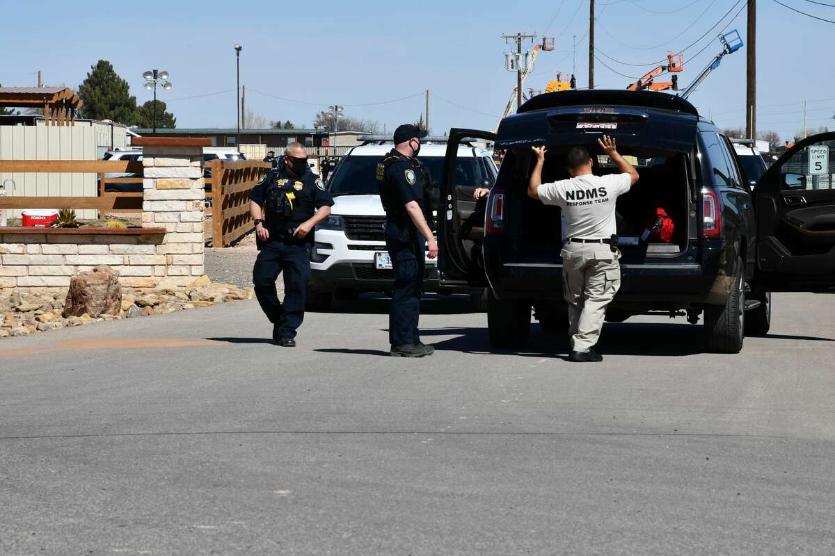 Department of Homeland Security officers stand at one of the entrances of a temporary holding facility in Midland County Monday, March 15, 2021. The holding facility opened Sunday, March 14, 2021, for migrant juveniles from the southern border of the United States. (Mercedes Cordero/Midland Reporter-Telegram )