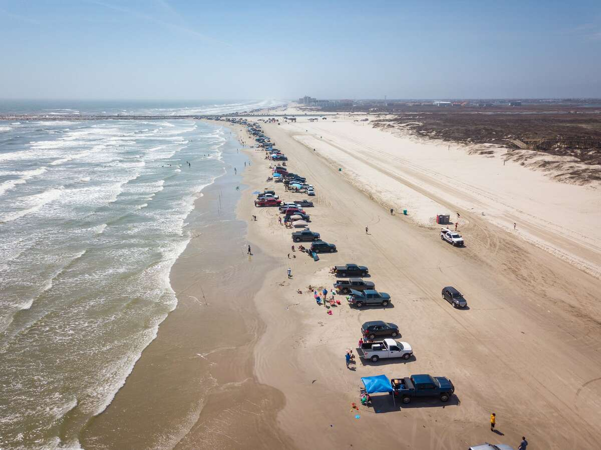 It's not only Texas beaches, like the one pictured here, that are filling up with visitors. Mexico's beaches have been full of tourists who officials believe are responsible for the rise in COVID-19 cases.