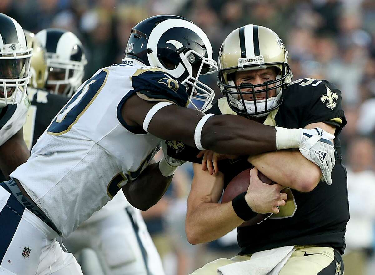 New Orleans Saints quarterback Drew Brees, right, is sacked by Los Angeles Rams linebacker Samson Ebukam during the second half of an NFL football game, Sunday, Nov. 26, 2017, in Los Angeles. (AP Photo/Kelvin Kuo)