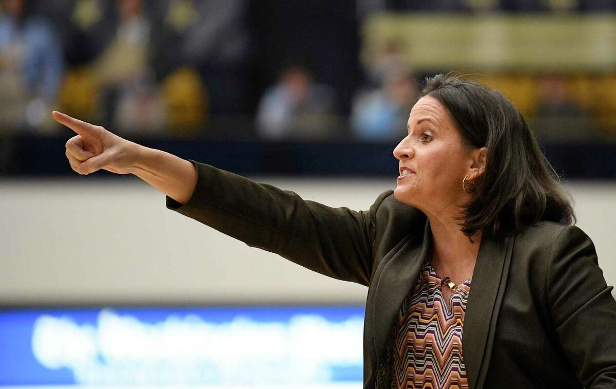 George Washington head coach Jennifer Rizzotti points during the first half of a game against Maryland on Wednesday in Washington.