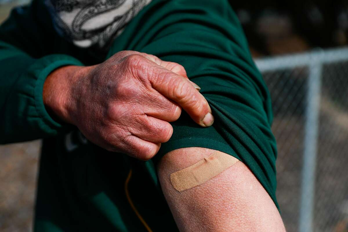Frank Bozdeck, 53, shows off his arm after receiving the COVID-19 vaccine on March 15 in Martinez.