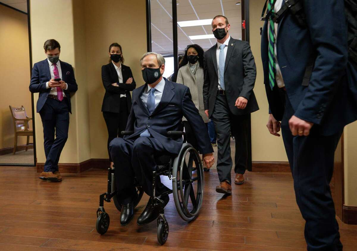 Gov. Greg Abbott exits a press conference at which he talked about a package of election reforms, at Senator Paul Bettencourt's District Office on Monday, March 15, 2021, in Houston.