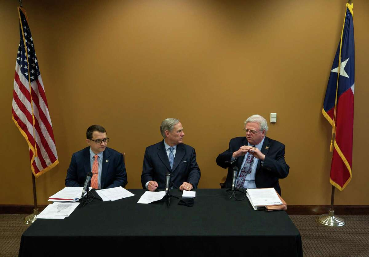 Representative Briscoe Cain, left to right, Gov. Greg Abbott, and senator Paul Bettencourt held a press conference to talk about a package of election reforms, at Senator Paul Bettencourt's District Office on Monday, March 15, 2021, in Houston.