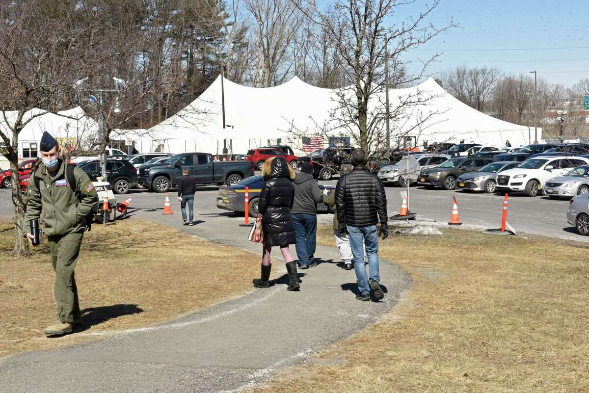 People are seen walking to the vaccination site set up at University at Albany to receive the COVID-19 vaccination on Monday, March 15, 2021 in Albany, N.Y. (Lori Van Buren/Times Union)