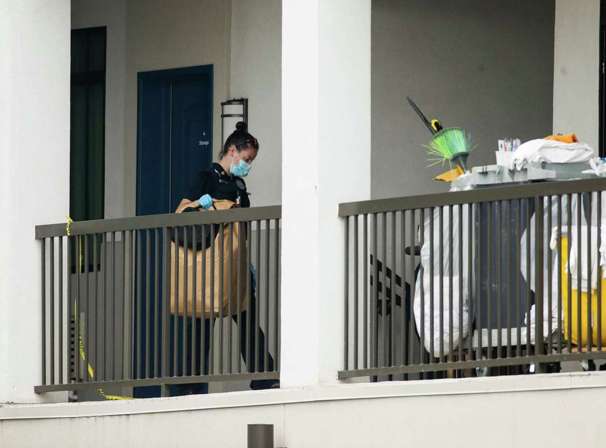 Houston Police officers and homicide detectives investigate the scene where a man was found decapitated inside a room at the Palace Inn Blue hotel Monday, March 15, 2021, in Houston.