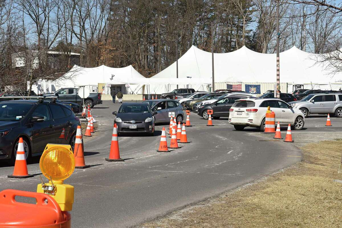 Cars come and go at the COVID-19 vaccination site set up at University at Albany on Monday, March 15, 2021 in Albany, N.Y. (Lori Van Buren/Times Union)