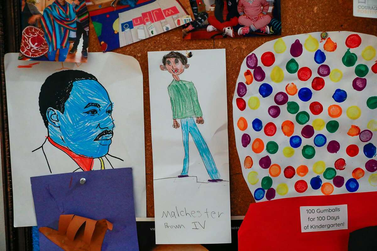 A self-portrait by Malchester Brown IV, 6, hangs on the wall of his Oakland home.