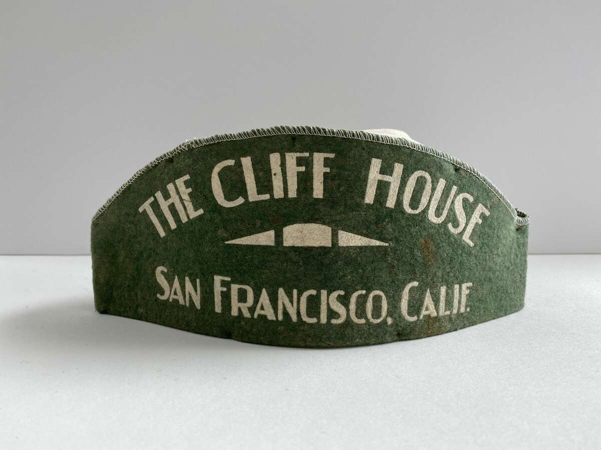 A Cliff House waiters' cap dating back to the 1930s was among the 60 or so artifacts salvaged by Nicole Meldahl, Alexandra Mitchell and John Lindsey.