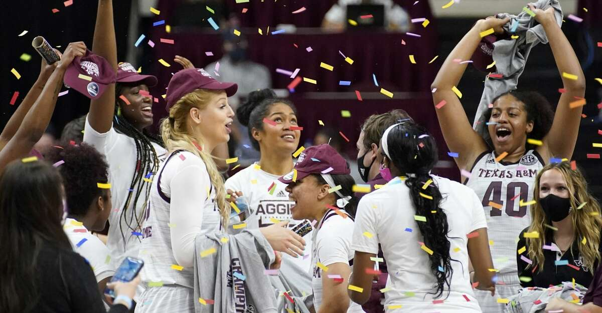 Members of the Texas A&M Aggies react after a win over South Carolina in an NCAA college basketball game Sunday, Feb. 28, 2021, in College Station, Texas. (AP Photo/Sam Craft)