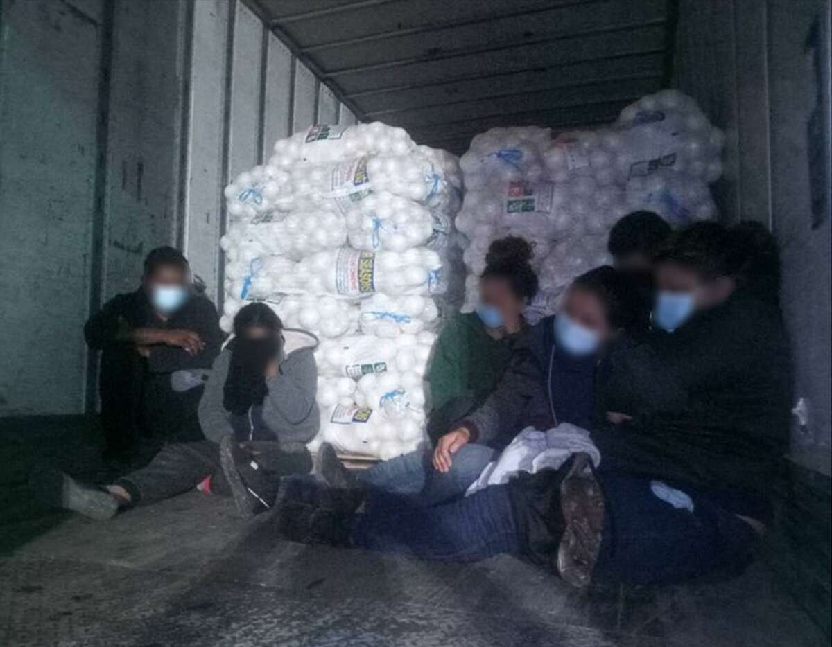 U.S. Border Patrol agents said they discovered these people in a cargo of onions. The individuals were determined to be immigrants who had crossed the border illegally.
