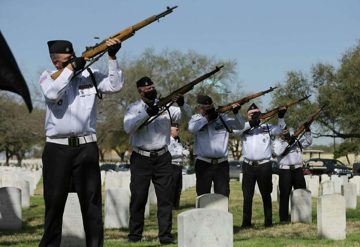 The volunteers of Fort Sam Houston National Cemetery's Memorial Services Detachment fire their rifles to honor World War II veteran Jose Lopez of Crystal City on Monday. It was the unit's 40,000th burial service.