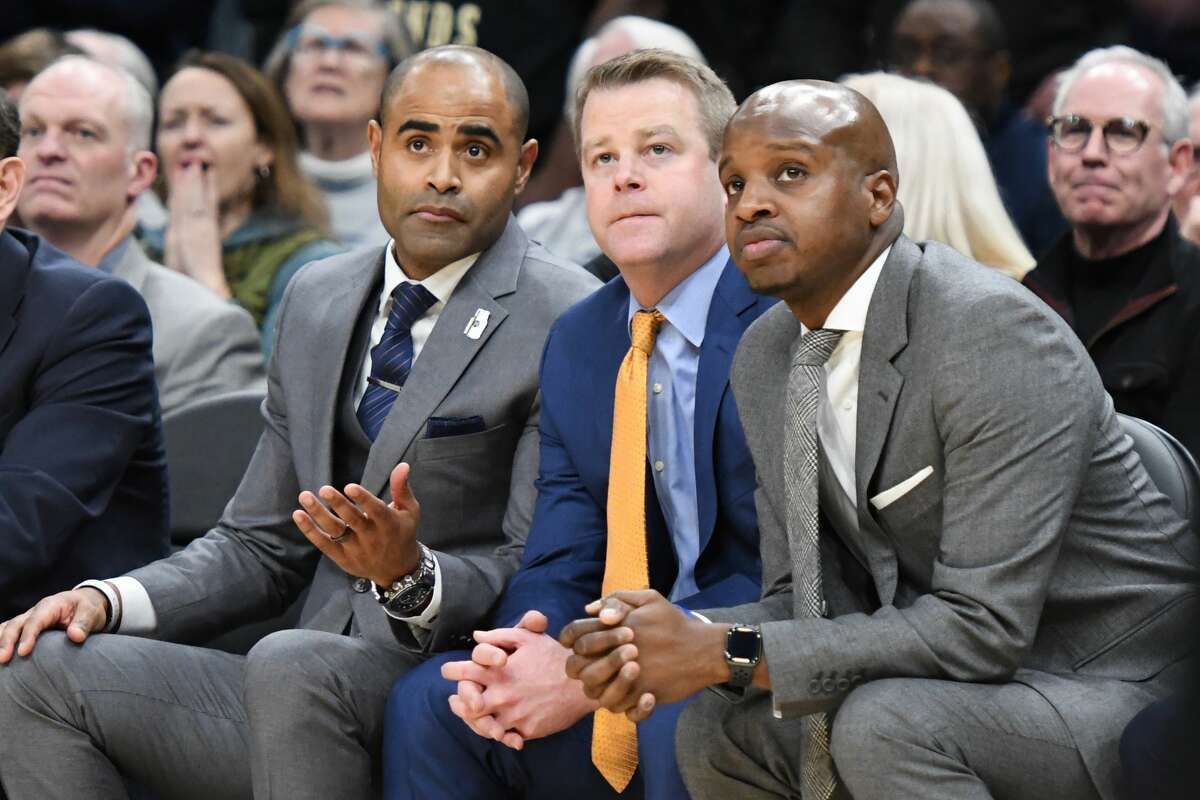 Dwayne Killings, left, sits on the Marquette bench with head coach Steve Wojciechowski, center, and fellow assistant coach Stan Johnson in a Jan. 18, 2020, photo. Killings has been reported to be the next University at Albany head coach. (Mitchell Layton/Getty Images)