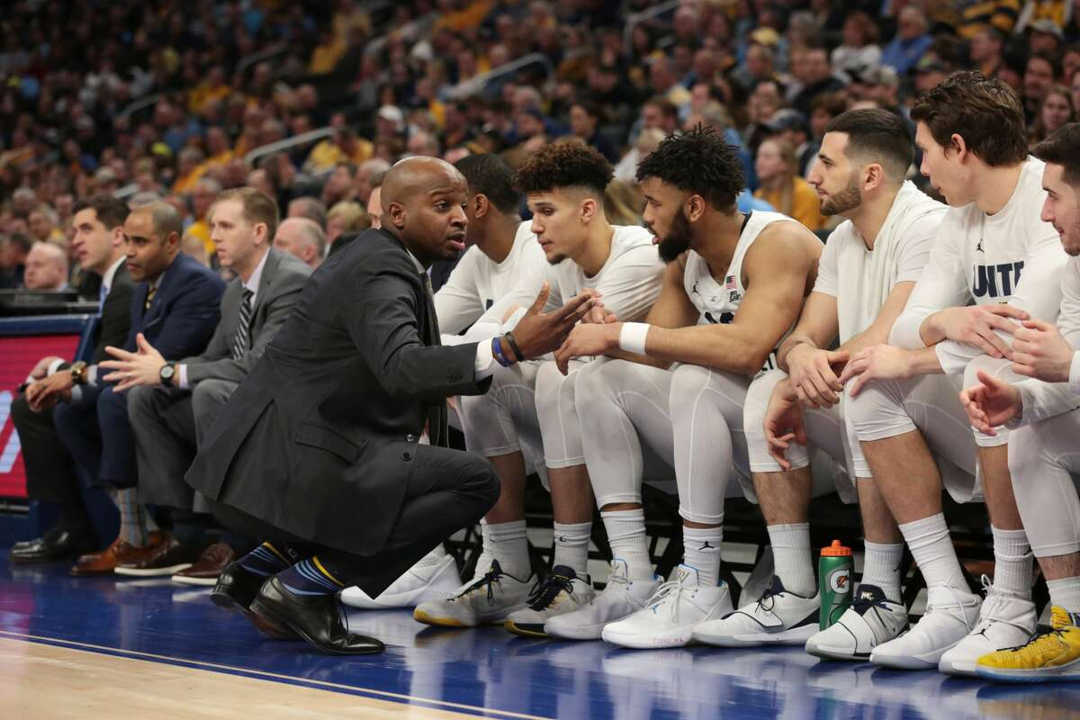 Dwayne Killings, who was an assistant at Marquette, brought Marquette's director of basketball operations Dan Madhavapallil with him to serve in the same post at UAlbany.(Photo by Larry Radloff/Icon Sportswire via Getty Images)