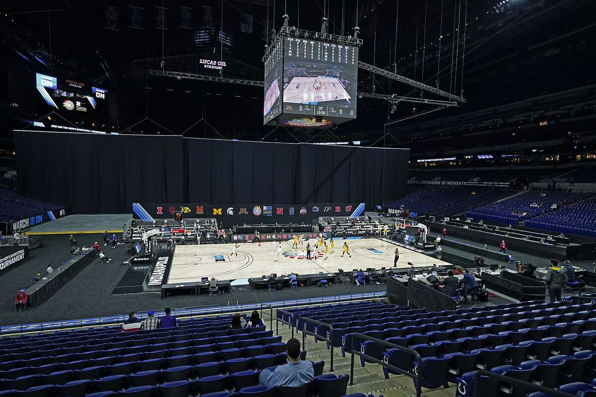 Minnesota and Northwestern play at Lucas Oil Stadium during the first half of an NCAA college basketball game at the Big Ten Conference tournament, Wednesday, March 10, 2021, in Indianapolis. Lucas Oil Stadium is one of six venues hosting NCAA Tournament games later this week. (AP Photo/Darron Cummings)
