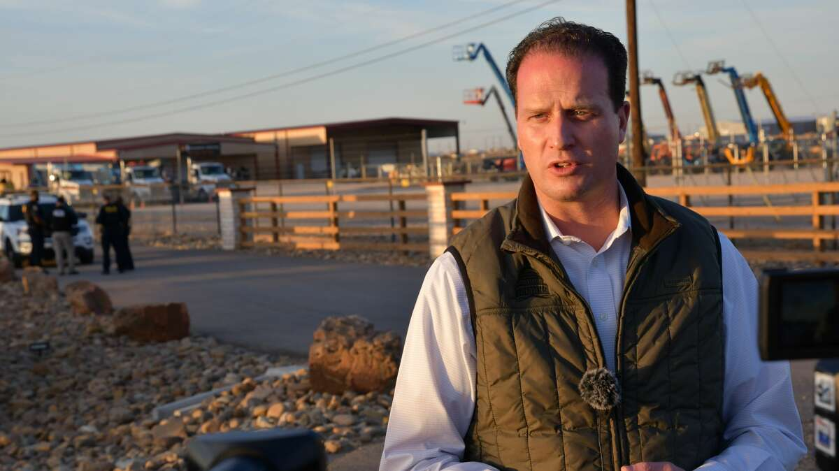 Congressman August Pfluger speaks at a press conference Monday, March 15, 2021 outside of a temporary holding facility for migrant juveniles that opened Sunday March 14, 2021 in Midland County. (Mercedes Cordero/Midland Reporter-Telegram)