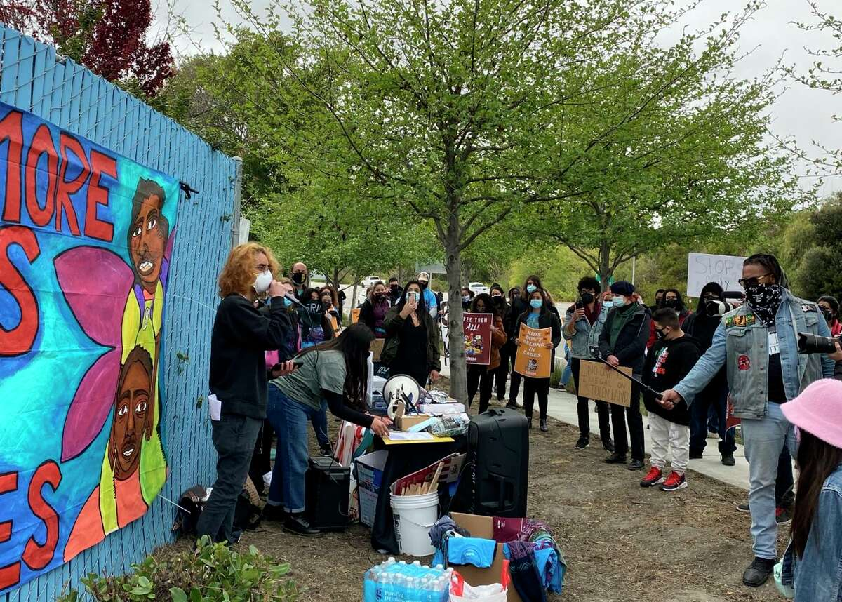 About 50 people demonstrated at Moffett Field in Mountain View Monday, where federal officials are considering housing unaccompanied migrant children.
