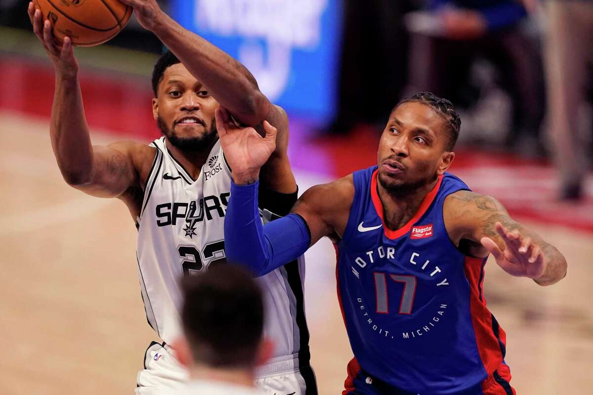 Detroit Pistons guard Rodney McGruder (17) reaches in on San Antonio Spurs forward Rudy Gay during the second half of an NBA basketball game, Monday, March 15, 2021, in Detroit.