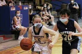 Manistee Catholic Central's Grace Kidd is guarded by Brethren's Toni Pate on Monday night. (Dylan Savela/News Advocate)