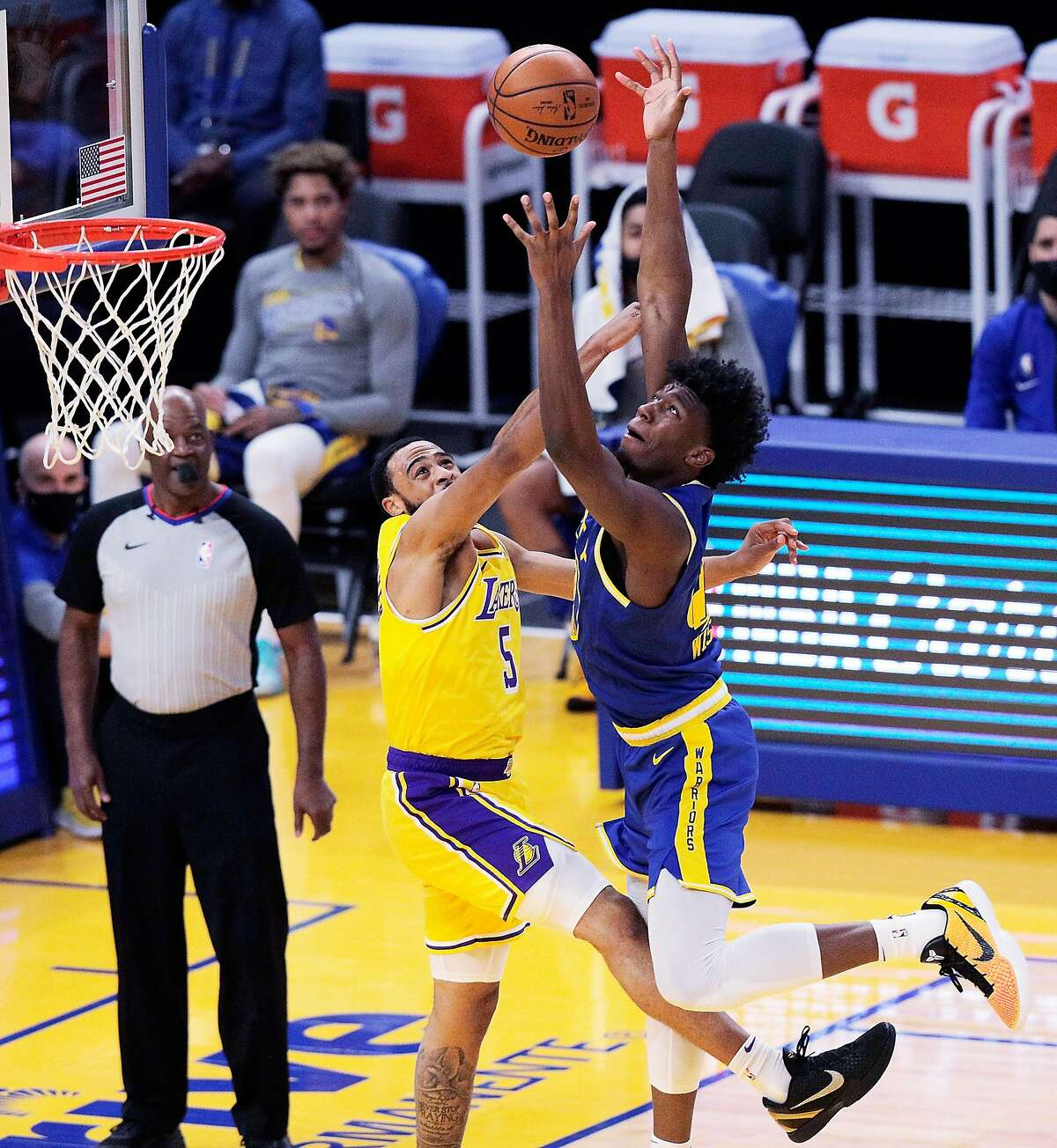 Warriors center James Wiseman (right) reaches for a rebound in the first half of the Warriors' loss.