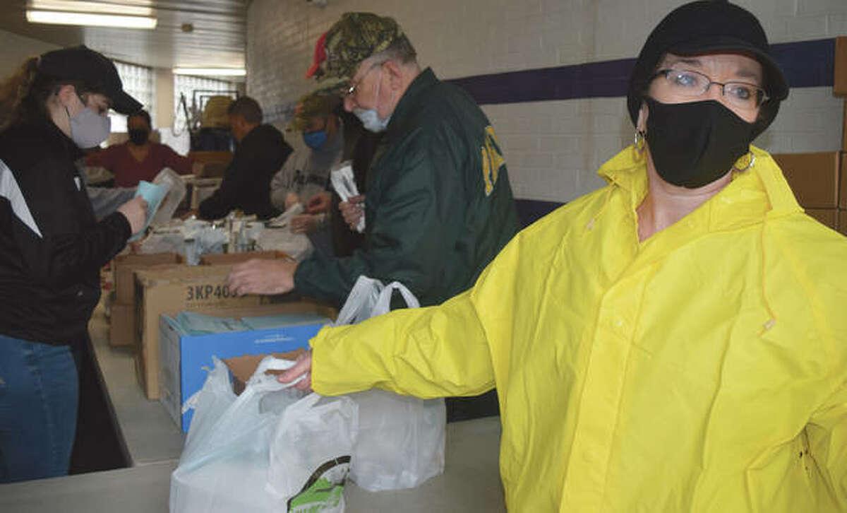 Kiwanis member Lori Oldenettel prepares to hand off an order Monday during the annual Kiwanis Pancake & Sausage Day.