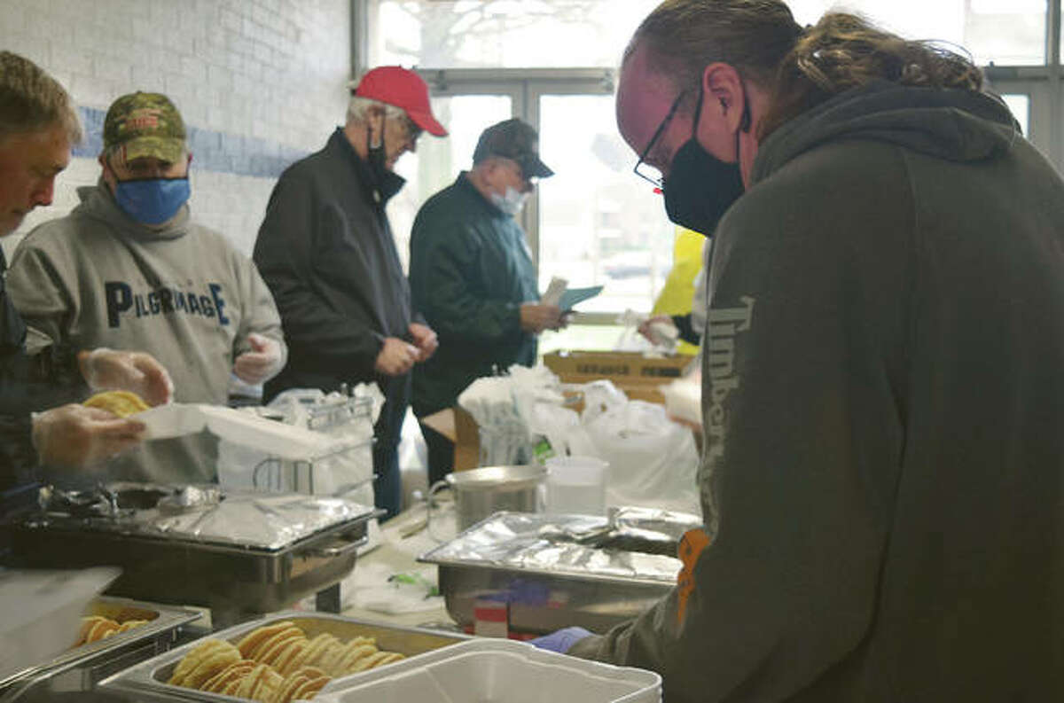 Kiwanis Club of Jacksonville member Rob Thomas makes a to-go box Monday during the group's annual Kiwanis Pancake & Sausage Day. Club members served hundreds of people throughout the day with drive-through service available on the west side of the Routt Catholic High School gym.