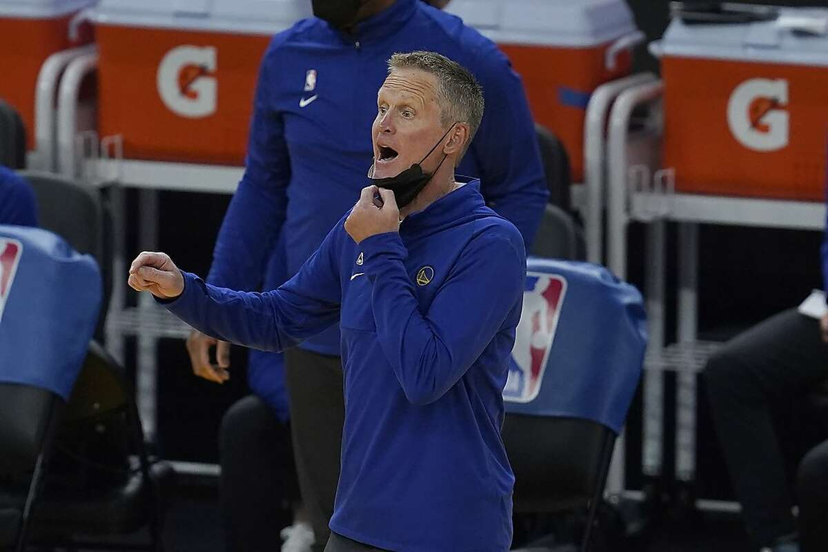 Golden State Warriors head coach Steve Kerr gestures toward players during the first half of his team's NBA basketball game against the Los Angeles Lakers in San Francisco, Monday, March 15, 2021. (AP Photo/Jeff Chiu)