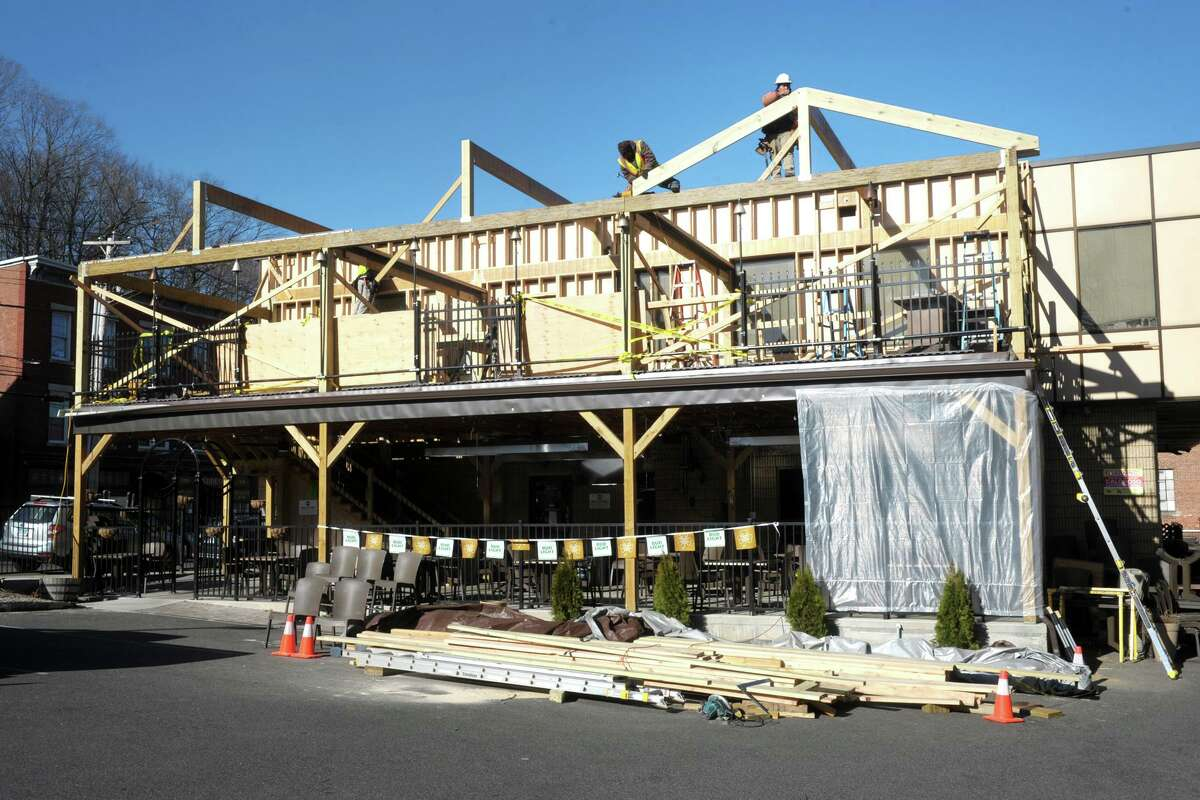 Construction of a new second floor, open-air skybox terrace continues above the recently completed outdoor dining patio at Caloroso Eatery and Bar, in Shelton, Conn. March 15, 2021.