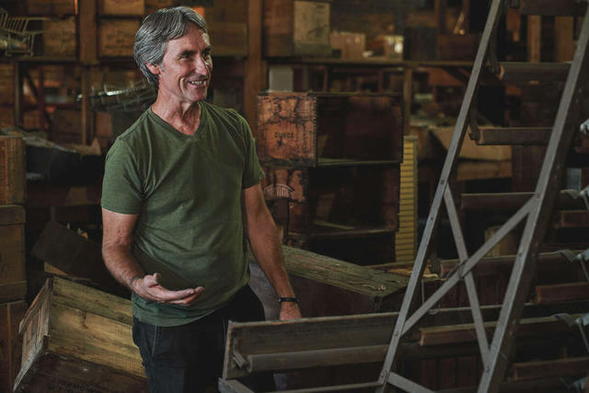 """Mike Wolfe assesses a collection as part of the television program """"American Pickers."""""""
