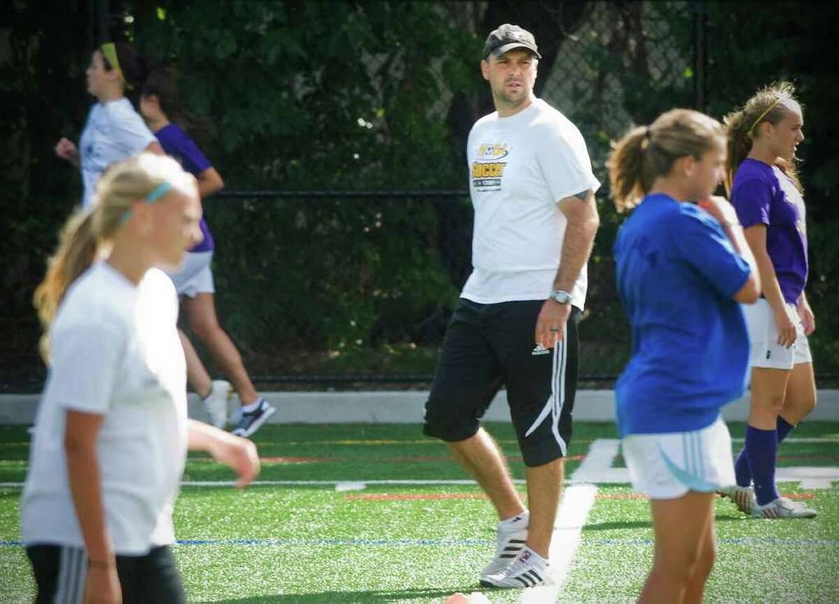 David Flower, head coach of Westhill girls soccer team, the defending state champions, conducts practice at Westhill High School in Stamford, Conn. on Thursday September 9, 2010.