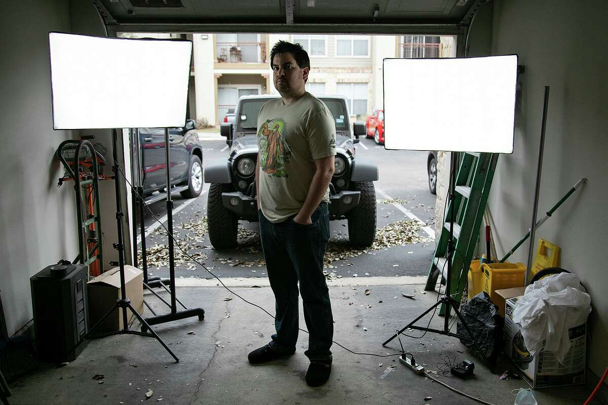 """Than Niles, standing in his garage turned film studio at his apartment in San Antonio, worked with Jesse Borrego on his latest short film, """"Luminous."""""""