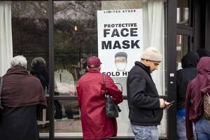 Customers line up outside of the coronavirus pop-up store by Adilisha Patrom, owner of the Suites DC, a co-working and event space across the street from Gallaudet University, who started her pop-up store that sells face masks, protective gloves, and hand sanitizer for customers concerned about the spread of the novel coronavirus which causes the COVID-19 disease in the NoMa neighborhood of Washington, DC on March 6, 2020. With the growing spread of the coronavirus around the world it is becoming harder and harder to find protective equipment and hand sanitizer around the country, especially the N95 protective face mask which Patrom is selling for $30, three times its regular cost. (Photo by Samuel Corum/Getty Images)